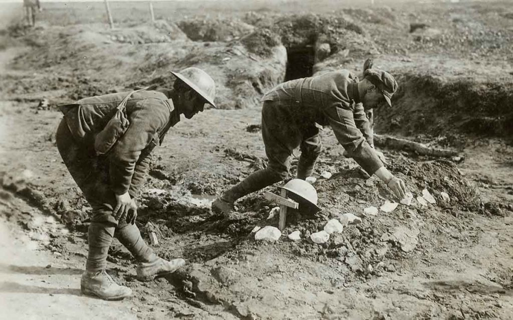 canadian soldiers tending to burial