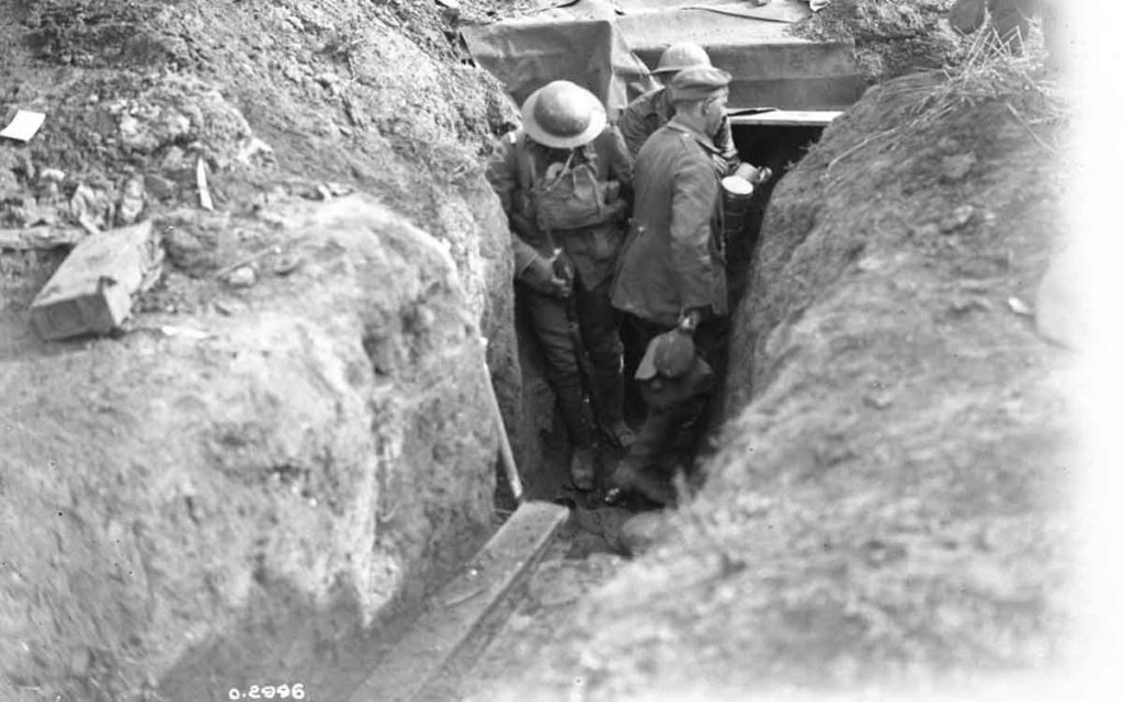 Canadian troops clearing trenches during the Battle of Amiens. The August 1918 battle kicked-off the Hundred Days Offensive. Credit: The Canadian Encyclopedia.