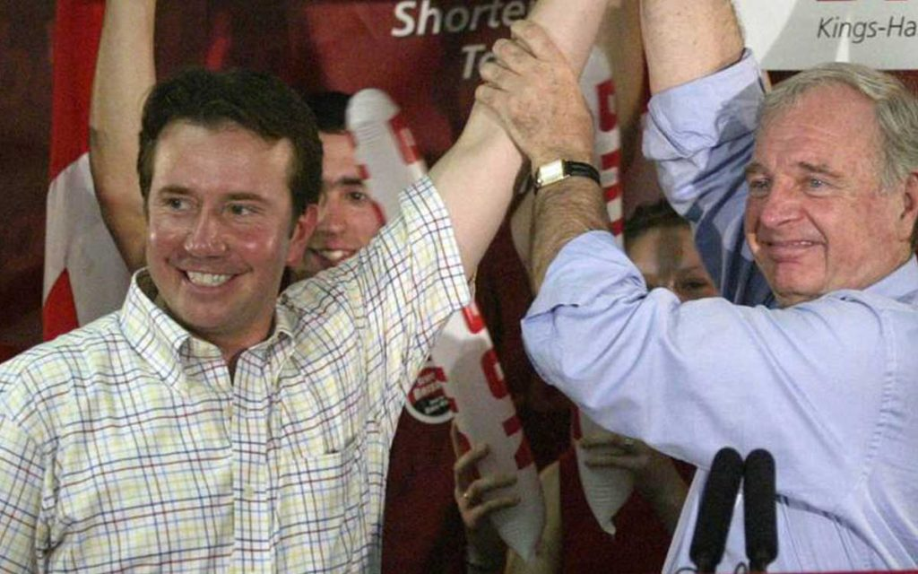 Former prime minister Paul Martin raises the arm of Liberal candidate Scott Brison during a 2004 campaign stop in Windsor.