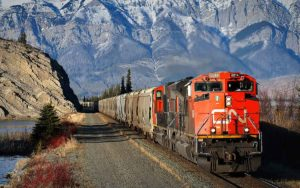 Canadian National Rail profit beats on higher crude, grain shipments, raises dividend