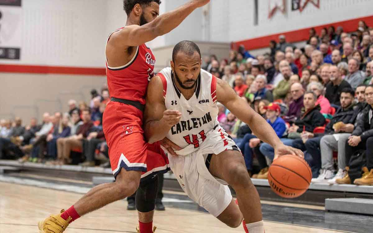 Brock's Tyler Brown (left) defends Troy Reid-Knight of the Carleton Ravens during the OUA semifinals in Ottawa on Wednesday.