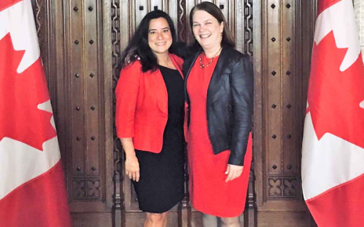 Former Minister of Justice Jody Wilson-Raybould with former Liberal cabinet minister colleague Jane Philpott.