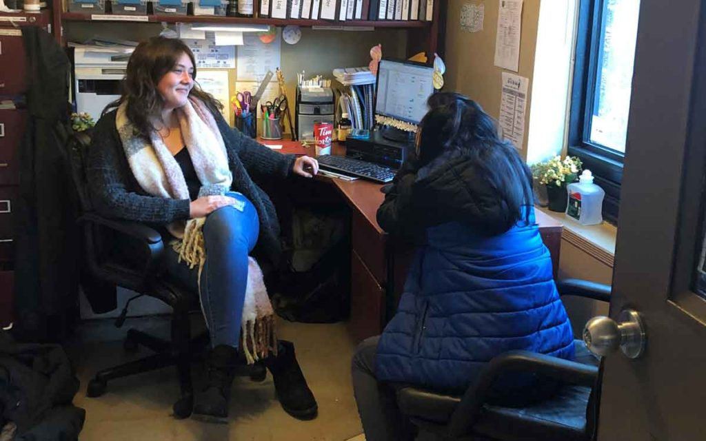 A Niagara youth speaks with a RAFT employee at the St. Catharines facility.
