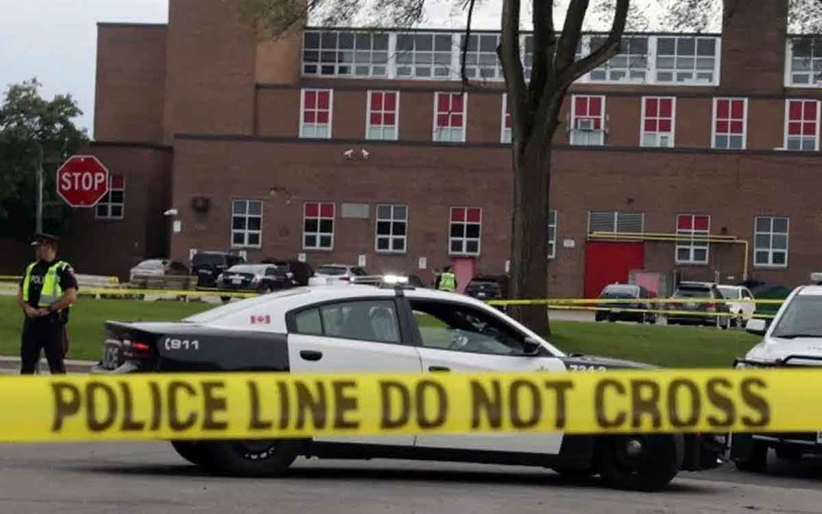 : Police seal off a crime scene at Sir Winston Churchill Secondary School