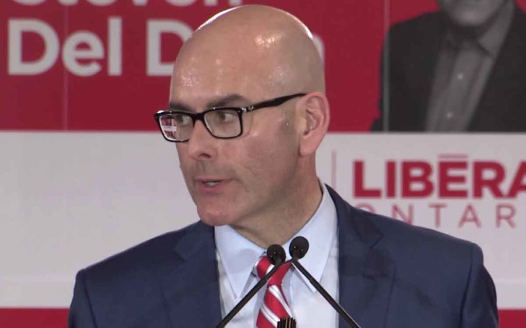 Stephen Del Duca at the mic
