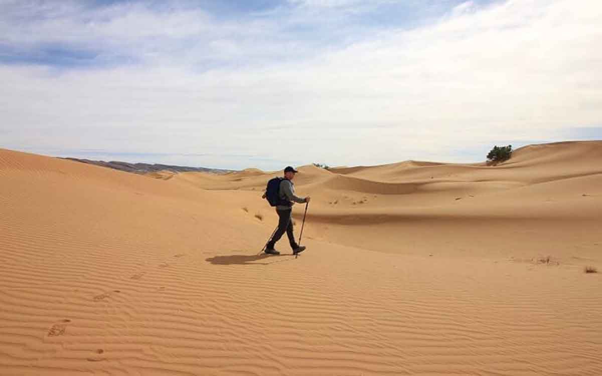 Michael Sommer walking in the desert