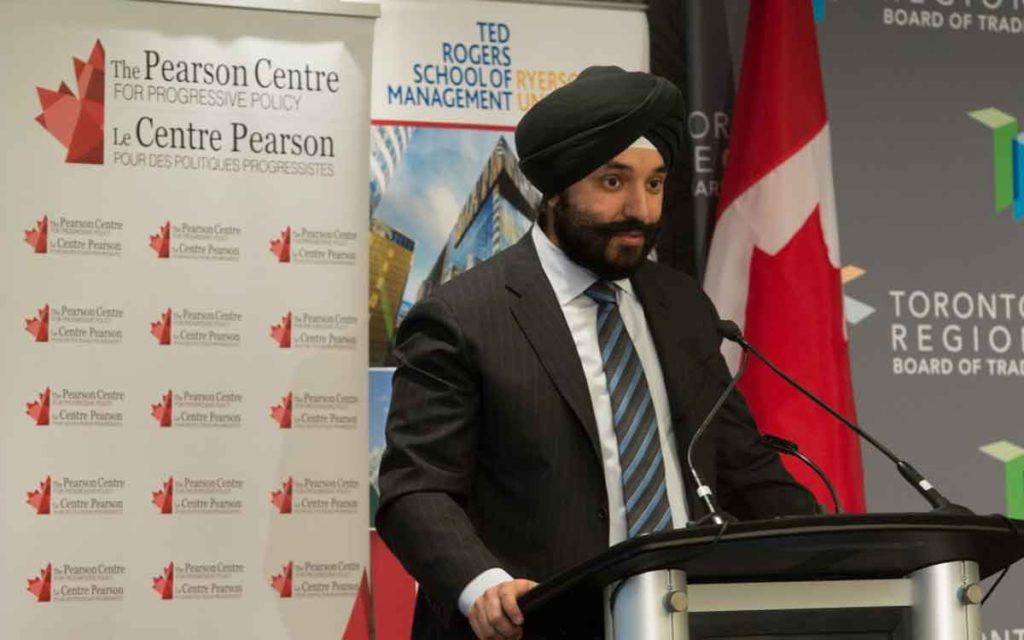Navdeep Bains stadning at a podium