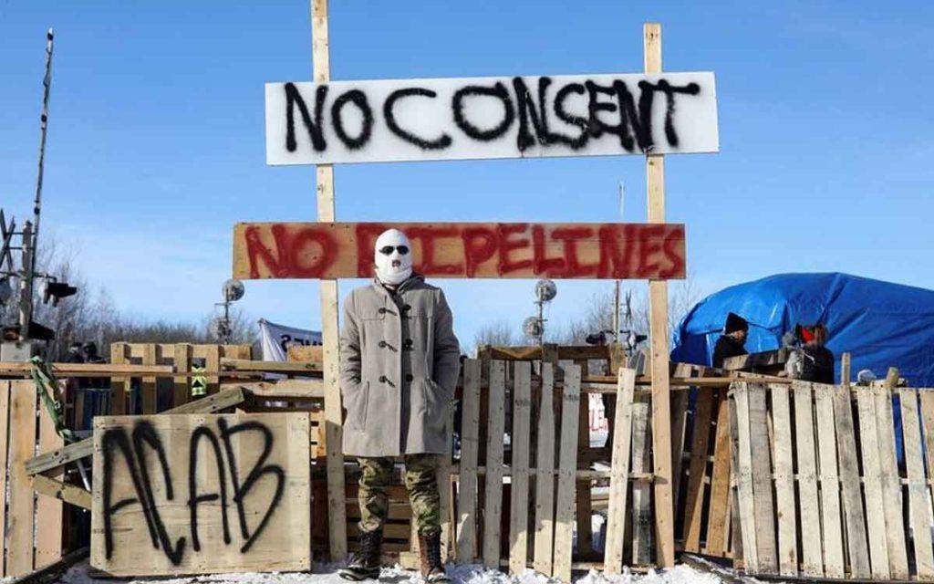 person at pipeline blockade