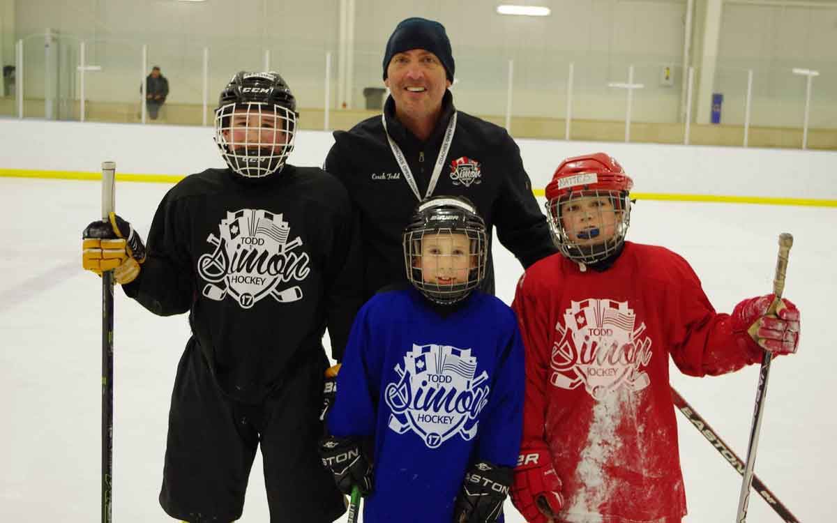 todd simon with participants of his hockey camp