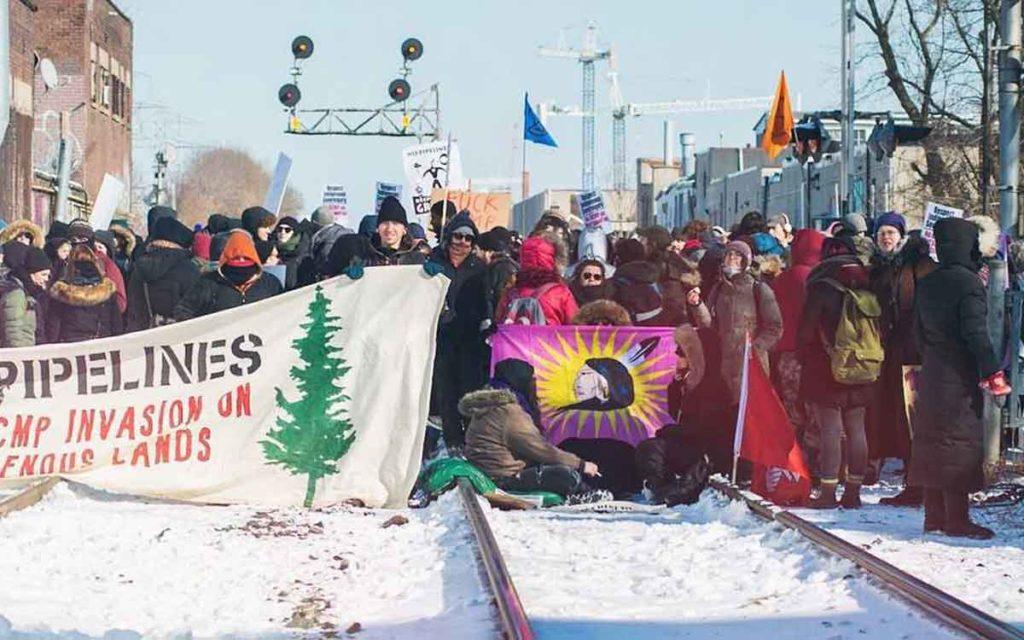 protestors blocking a rail line