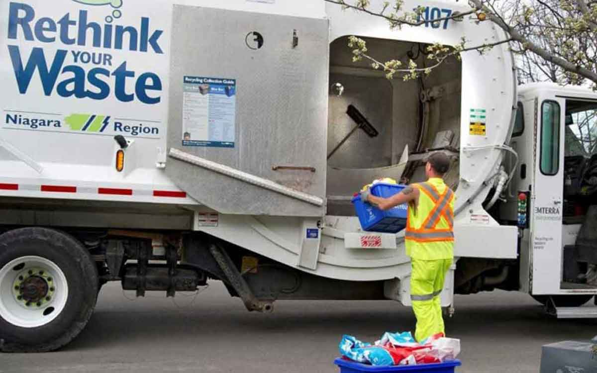 worker picking up recycling