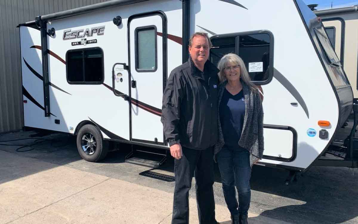 Niagara RV owner John Petrie and his wife Anna beside one of the trailers
