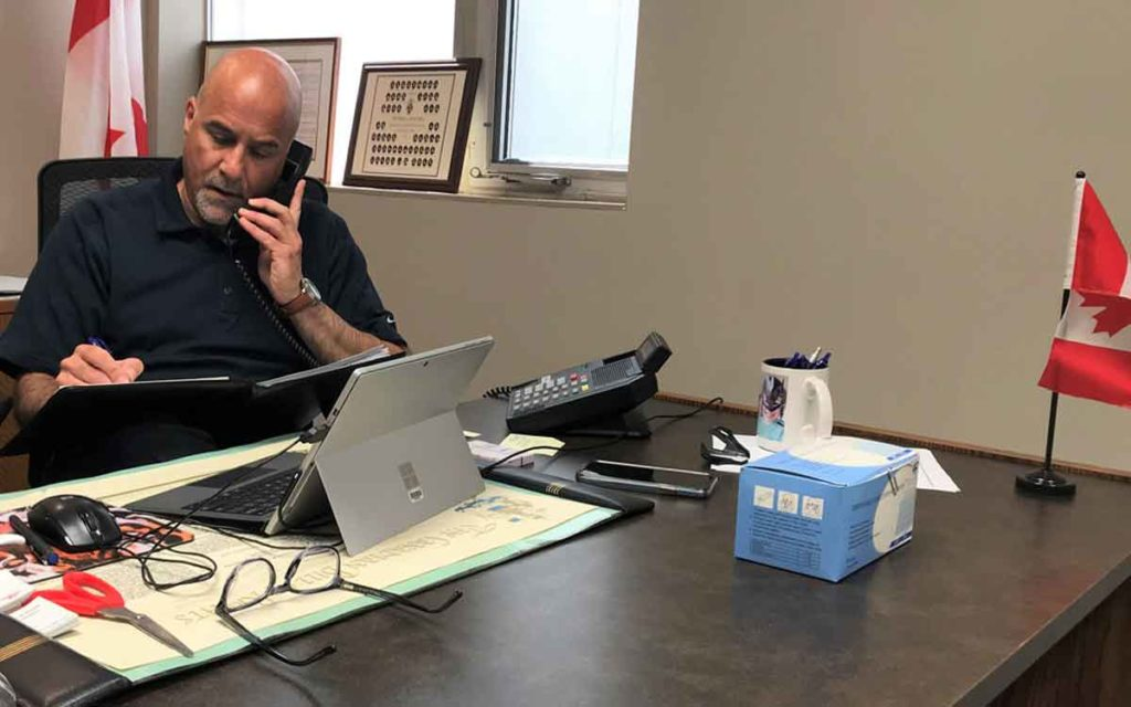 Niagara Falls MP Tony Baldinelli on the phone