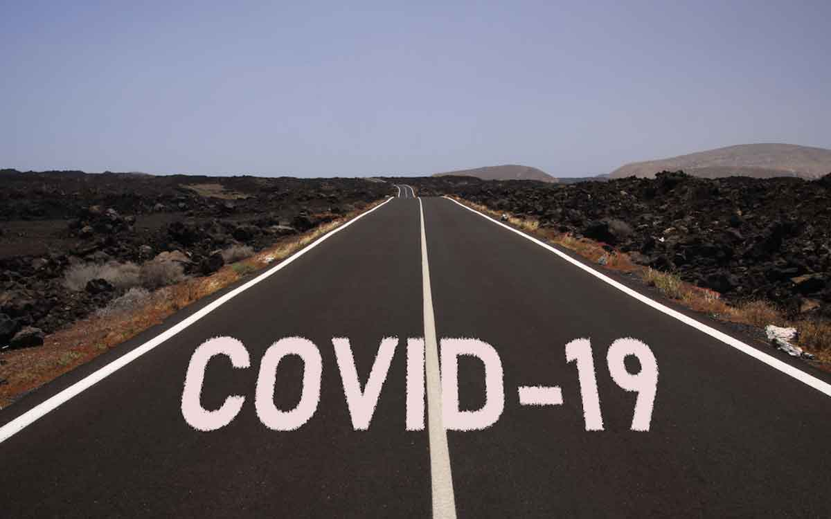 "a road with the words ""covid-19"""