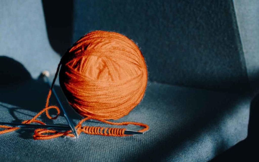 a ball of yarn and knitting needles