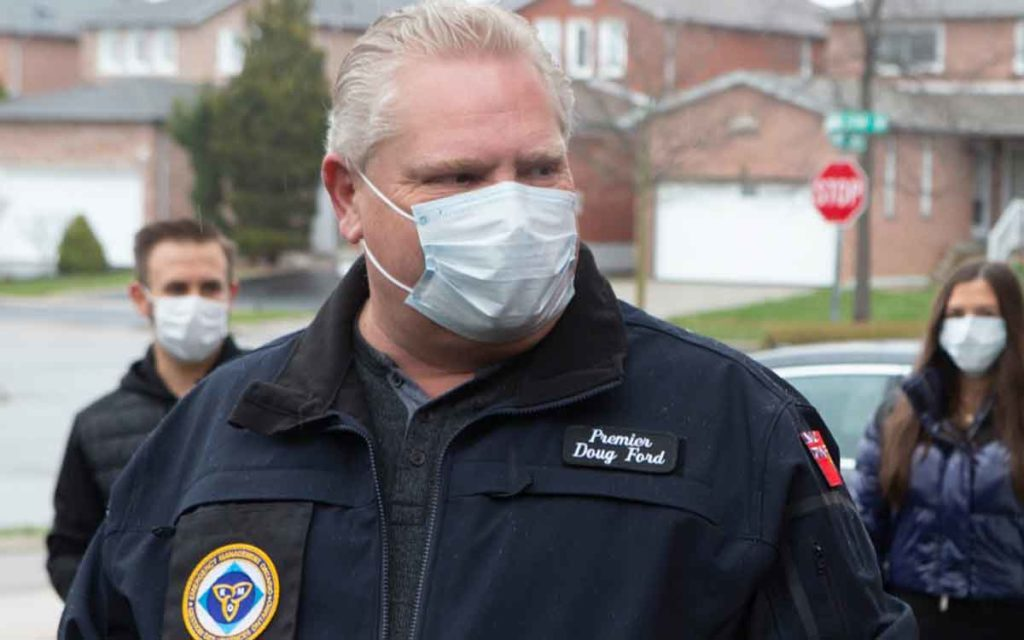 Premier Ford wearing a face mask