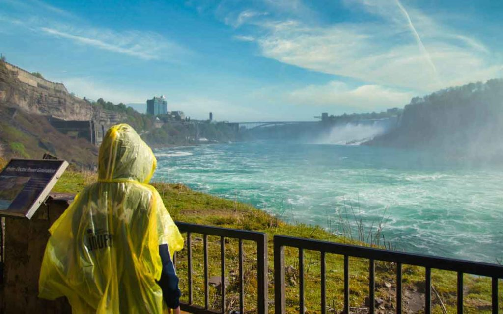 a tourist standing at the falls