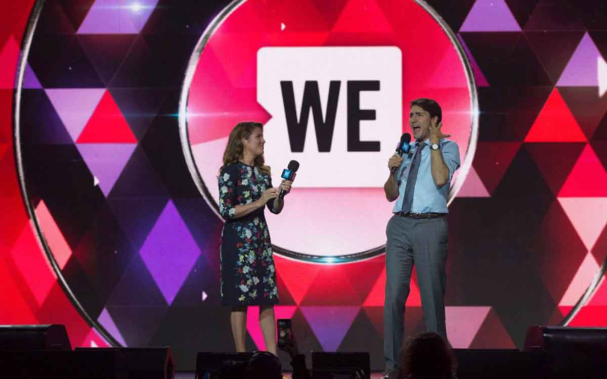 Sophie and Justin Trudeau on stage at a WE event
