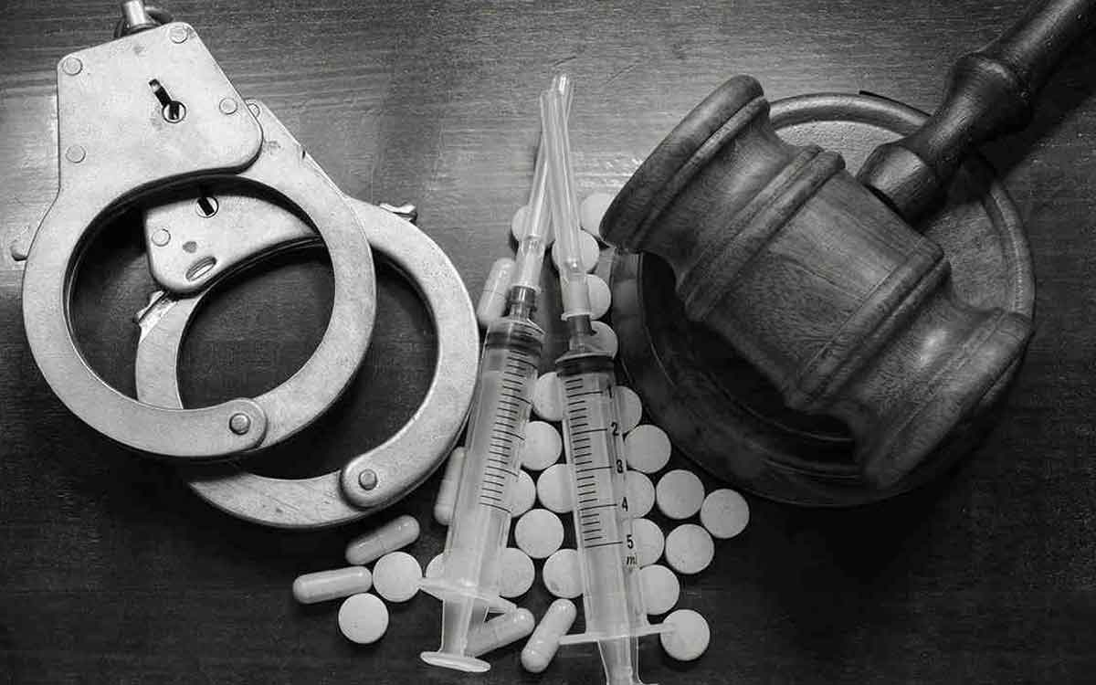 handcuffs, drugs and a gavel