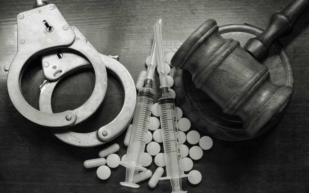 handcuffs, syringes, and a gavel