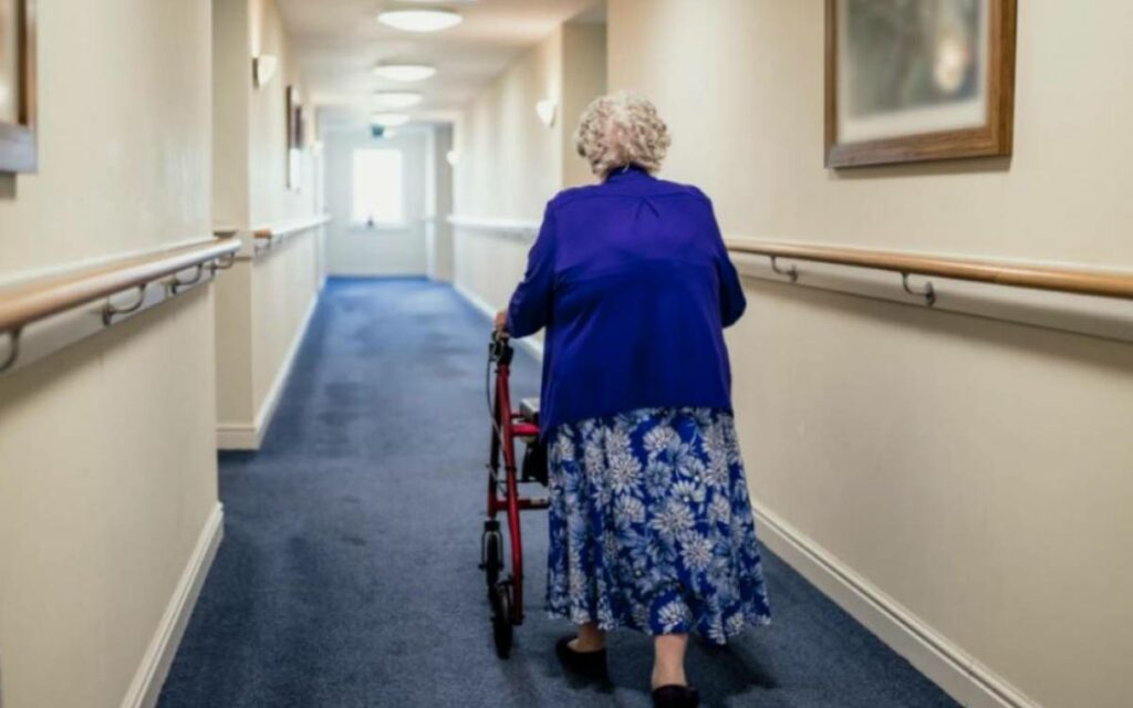 a senior walking down the hall