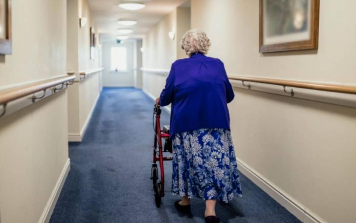 a senior walking down the hall