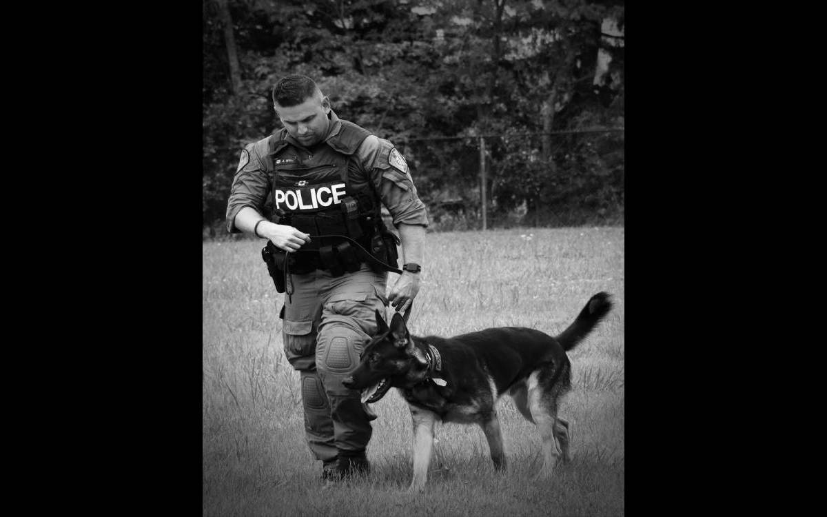 Officer Tim Wiley with his partner Rudy