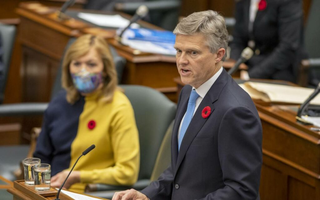 Minister Rod Phillips delivering the budget