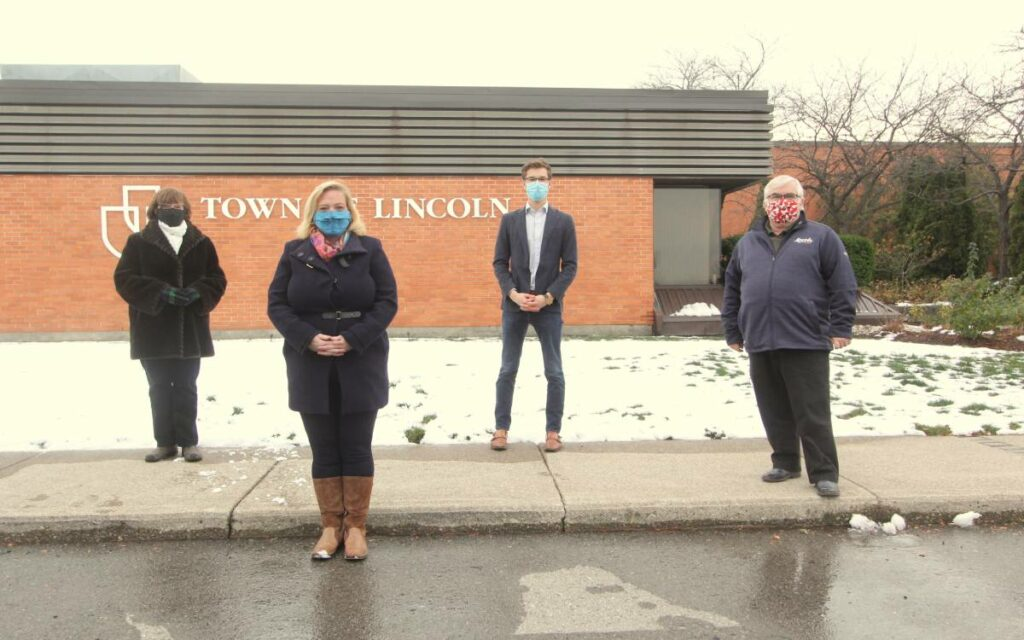 politicians in front of west lincoln town hall