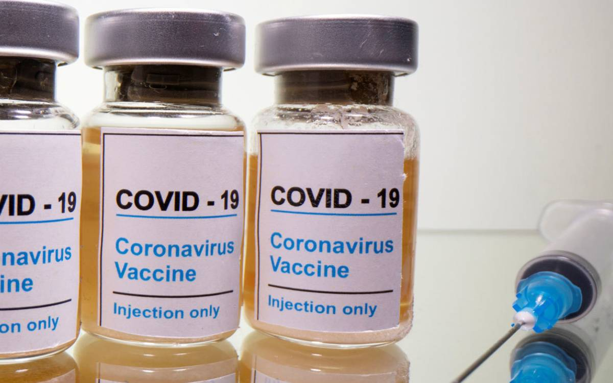 covid vaccine and a syringe