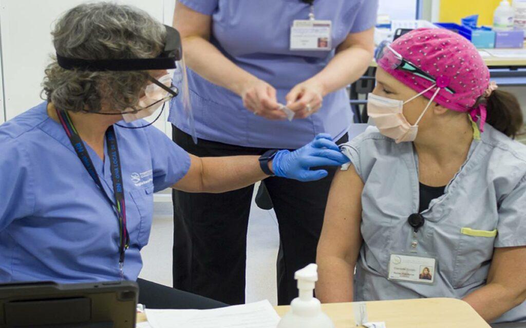 nurse getting the covid-19 vaccine