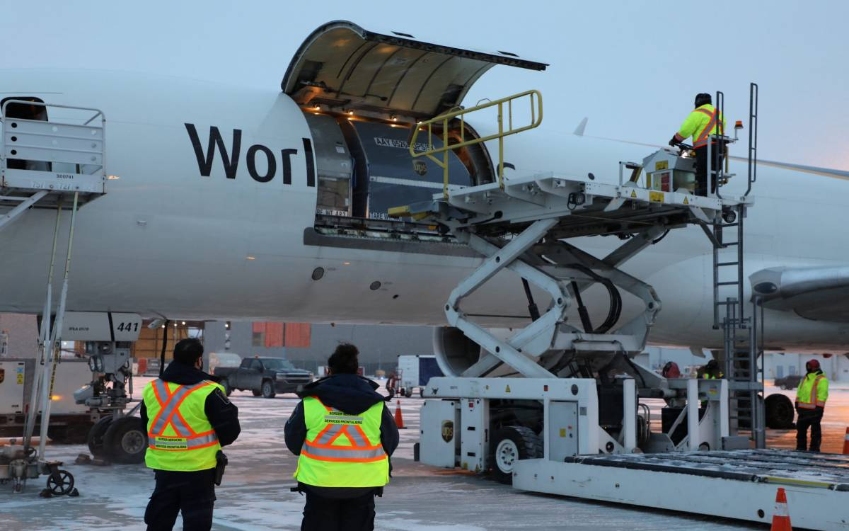 unloading the vaccine from a plane