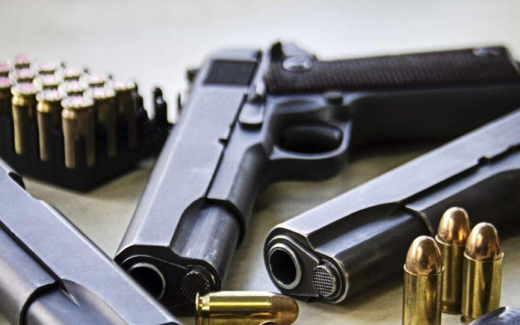 a handgun and bullets