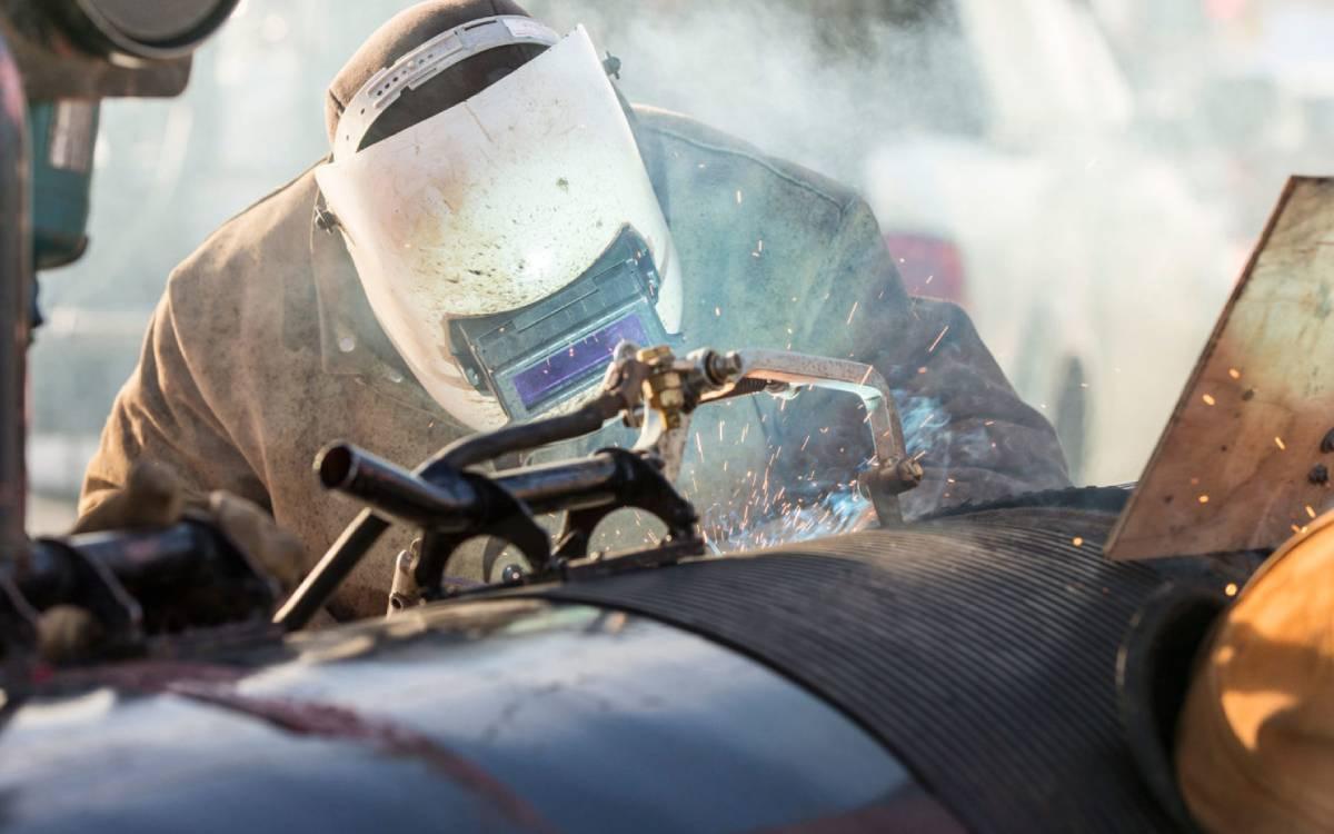 a welder working on a pipeline