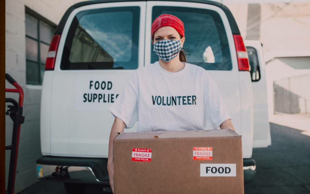 volunteer carrying a box