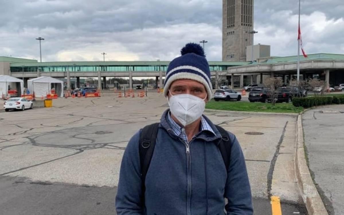 man in mask at the bridge