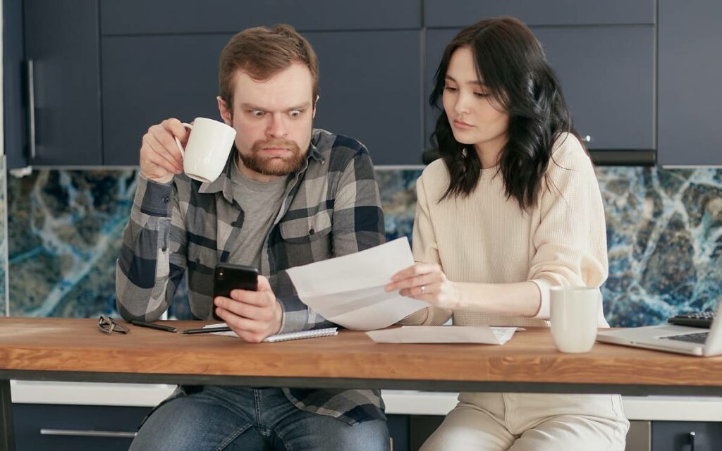 two people looking over a document