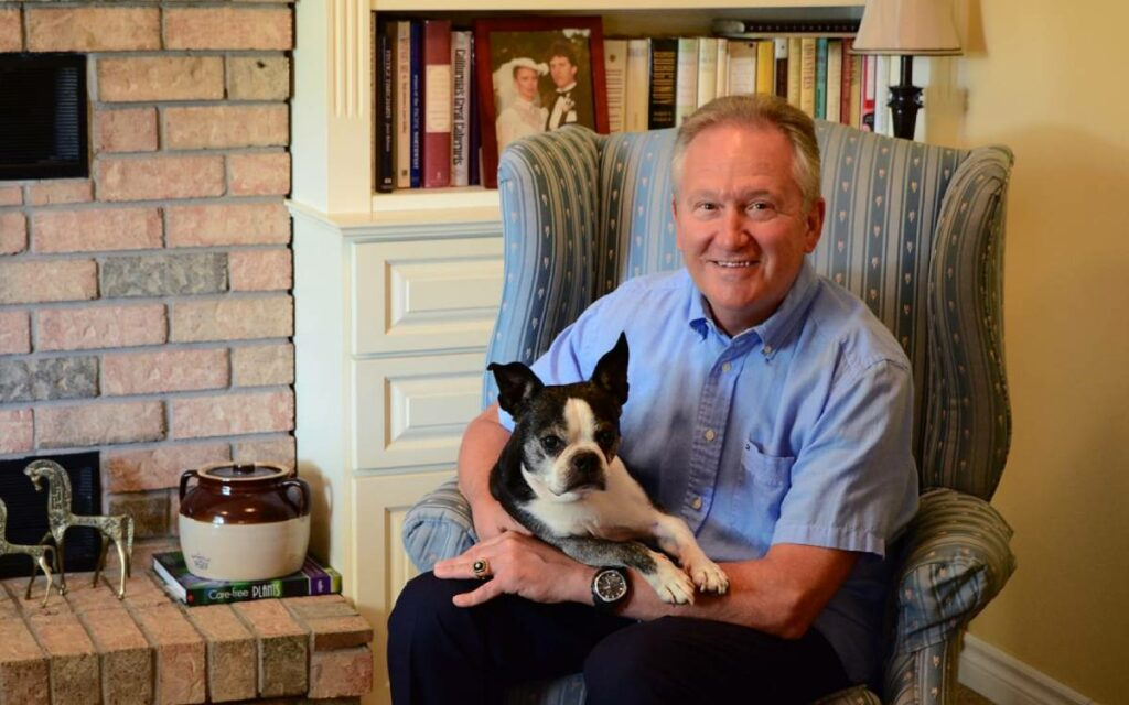 Mayor Terry Ugulini on a chair with his dog
