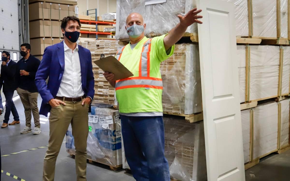 PM trudeau in. a warehouse