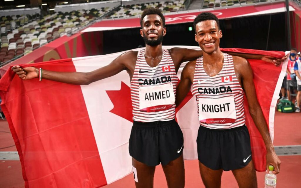 Mohammed Ahmed holding a canadian flag