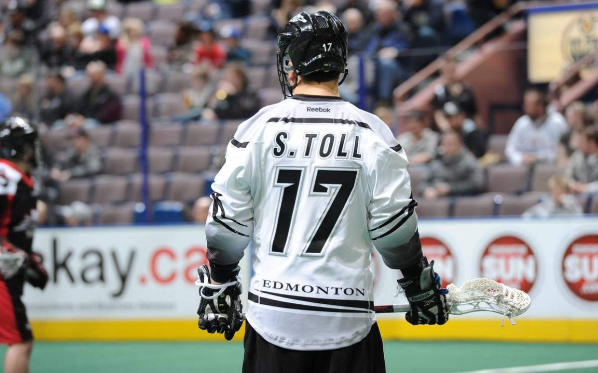 Steve Toll playing lacrosse